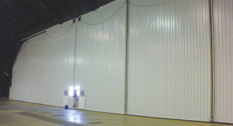 Refurbishment bottom rolling hangar door 1